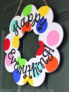 This is AWESOME!!  I love how it's so colorful and cheery, and that you can hang it anytime of year!  Year-Round Happy Everything Wreath: A Coton Colors Knock Off! | Where The Smiles Have Been