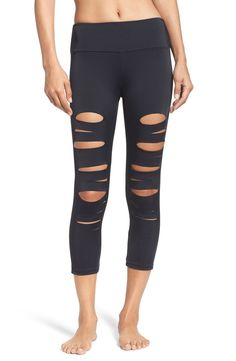 Sliced, skin-baring holes down the front make an edgy, of-the-moment update for sleek, stretchy capri leggings topped with a wide contoured waistband.