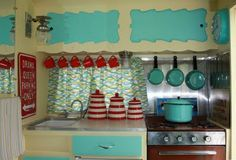 This photo is from a Shasta 1400. Smart way of storing cups, pots, and pans.