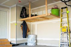 Garage Storage | Garage Organization Ideas | Home Organization Tips  Take advantage of garage nooks with platform storage designed to hold seasonal items, such as sporting equipment and Christmas lights, that you tuck away for months each year. Fasten the platform to wall studs and suspend it from ceiling joists so you won't need legs underneath.