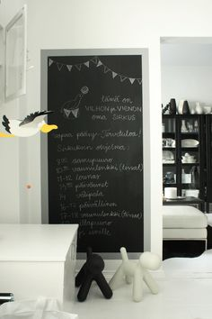 paint ikea framed mirror with pink chalkboard and lean against pantry wall