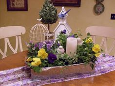 Mother's Day Centerpiece with purple and yellow pansies and ivy in a metal seed tray.