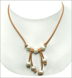 Natural large hole freshwater pearls with thick leather cord are big in rustic jewelry design right now, so we...