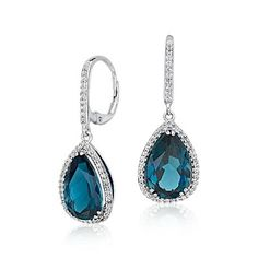 Stay gorgeously on trend with these blue topaz ombré drop earrings. Two ocean-colored, faceted gemstones in sky and London blue hues cascade in graduated sizes. Each gem is set in a slim 14k yellow gold bezel. The blue topaz drops hang delicately from 14k yellow gold lever backs for pierced ears.