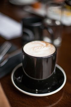 Beautiful black cup and saucer makes this cappucino look so smooth and delicious