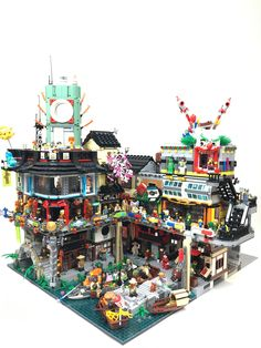 https://flic.kr/p/H33Yes | Ninjago City extension | This is stage 1 of my planned Ninjago City expansion - I envisage adding more to the righthand-side and aso seeing where the Ninjago Docks set will fit. Going to try to get the Temple of Airjitsu in there somewhere, as well as a pirate inn, a police station and some industrial background to give it a more neo-noir feel overall. I also need to add in more set-decorations: better signage and posters etc.