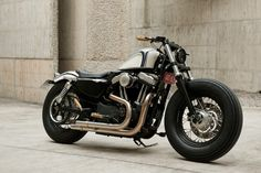 The Shattered Pearl built in 2011 by Rough Crafts motorcycles, Winston Yeh (Taiwan). Yeh took a 2011 Sportster Forty-Eight, and started to design parts in his tiny Taipei workshop. Harley Davidson 48, Harley Davidson Breakout Custom, Harley Davidson Pictures, Harley Davidson Sportster 883, Harley Davidson Street Glide, Harley Davidson Motorcycles, Custom Motorcycles, Vintage Motorcycles, Cafe Racer Helmet