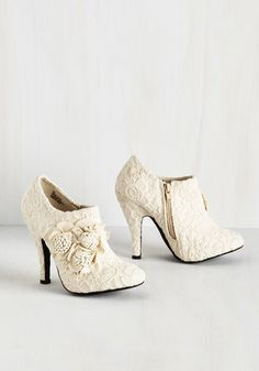 Spice things up by stepping into these dreamy beige and ivory booties from Dolce by Mojo Moxy. Swathed in delicate crocheted lace and adorned by ornate floral appliques, this high-heeled pair sets the pace for vintage-inspired charm!