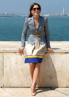 Crown Princess Mary of Denmark.  I love belts on top of blazers and cardigans.