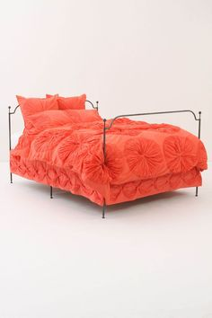 Coral bedding. This is going to be my color for the summer. Might as well start in the bedroom
