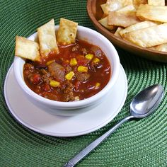 All-Day Tortilla Soup - This tortilla soup recipe cooks all day, and it's packed with ground beef, corn , beans, tomatoes and more. This dish is hearty and delicious! #SlowCookerRecipes #SlowCookerRecipes