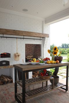 Outdoor kitchen with a pizza oven, definitely a must.