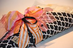 bold black and white graphics with contrasting girlish pink and orange ribbons!