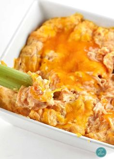 Buffalo Chicken Dip Recipe - This delicious dip is like the buffalo chicken wings we all love without messy fingers! It's a family favorite that comes together quickly! So delicious! //addapinch.com