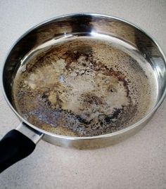 How To Clean Burnt Pans   1 cup of vinegar 2 tablespoons of baking soda 1 cup of water (give or take depending on the size of your pan) A burnt stainless steel pan that was left empty and unattended on a heated hot plate. oops!. A scourer  1. Fill the bottom of the pan with a layer of water. 2. Add the vinegar. 3. Bring the pan to the boil. It should be looking a bit cleaner already. 4. Remove the pan from the heat and add the baking by Colorado.Mary.S