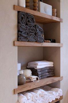Built-in shelving for the bathroom. Good idea for our small shelf outside the bathroom #smallmodernhomedesign