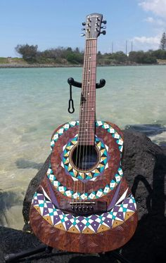 Wood burnt and painted travel guitar #art #guitar