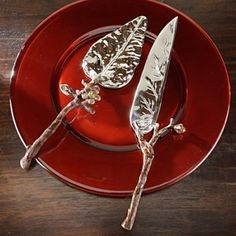Leave and branch cake servers. I'd like them a little more simple than these but the idea is really cool