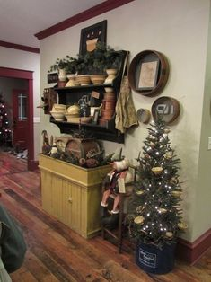 Mustard dry sink, antique sifters, shelf with soooo many prims. . .