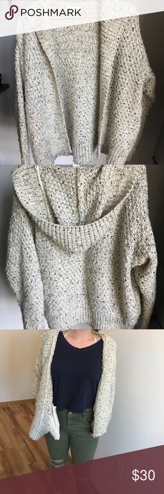 Oversized knit H&M sweater-hoodie White and black sweater, worn a few times but in perfect condition! You can pair this with cute skirts, jeans, or with sweatpants for a cozy day in front of the fire :) size small but easily fits a medium like me. H&M Sweaters
