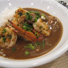 Emeril's Classic Seafood Gumbo -- Some form of gumbo is always on the menu at Emeril's Restaurant. This classic seafood version, which is chock-full of shrimp, fish, and oysters swimming in a broth richly flavored with gumbo crabs, is always a hit. Creole Recipes, Cajun Recipes, Fish Recipes, Seafood Recipes, Soup Recipes, Cooking Recipes, Gumbo Recipes, Haitian Recipes, Steak Recipes