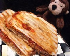 Meatball Sub Panini from Food.com:   A new spin on the classic meatball sub.  This works great especially when you only have sliced bread on hand and no hoagie rolls. The panini effect keeps the sliced bread from getting soggy.