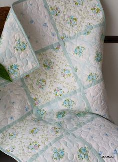 Baby quilt made from 4 coordinating vintage sheets