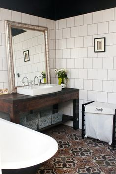 Salvaged Spanish floor tiles; workbench turned into vanity >> Etica Studio - The Recycled House | House Nerd