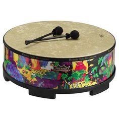Woodstock Remo Kid's Gathering Drum Small KG22 by Woodstock. $145.00. Durable, colorful and fun for kids of all ages. Constructed with pre-tuned heads and colorful drum shells.. This drum is large enough for 2 or more players.. Use the included mallets, or drum away with your hands or drumsticks.. Made in the tradition of fine handcrafted ethnic instruments.. Gathering Drums are used to bring people together. This version by Remo is durable, colorful and fun for kids of al...