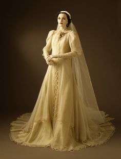 Woman's Wedding Dress and Veil Gilbert Adrian (United States, 1903-1959) United States, California, 1937 Costumes; Accessories Silk organza, silk taffeta, linen lace a) Dress center back length: 102 in. (259.08 cm) Gift of Miss Jeannette MacDonald (63.12.1a-c) Costume and Textiles Woman's Wedding Dress and Veil | LACMA Collections