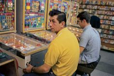 Men playing pinball. By William Eggleston, 1970s. - Gee Whiz: midcentury life and other things.
