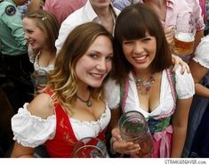 Old-school: The traditional drindl dress was a popular choice among young women at Oktoberfest Oktoberfest Outfit, Oktoberfest Beer, Octoberfest Girls, Drindl Dress, Beer Maid, Austria, Beer Girl, German Women, German Girls