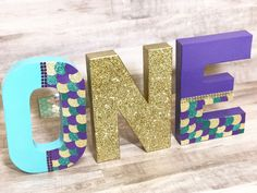 Mermaid Letters - Mermaid Party - One Letters - Glitter Letters - Glitter One Letters - mermaid decorations- Mermaid Birthday Decorations by IttyBittyMilestones on Etsy https://www.etsy.com/listing/564940105/mermaid-letters-mermaid-party-one