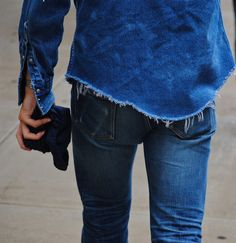 jean on jean I love the shredded hem line look on this dark blue denim shirt