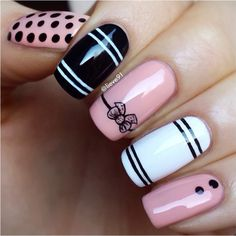 Pink, white and black nail design