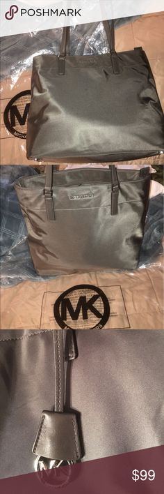 Michael Kors Morgan Tote Excellent condition . Graphite in color. Smoke free home. Comes with Michael Kors plastic shopping bag. Michael Kors Bags Totes