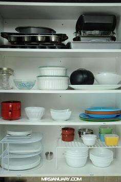 Organized Kitchen Cabinets via MrsJanuary.com #organizing