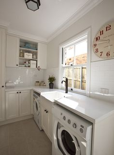 Suzie: Porchlight Interiors - Clean open laundry room design with ivory Ikea  kitchen cabinets,