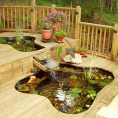 "Have Your Deck—and a Pond, Too    Tom Hardy wanted a pond and a bigger deck, but he couldn't decide which he wanted more for his house in Canton, Georgia. So he enlarged the deck and put two ponds in it. He used rigid plastic tubs for the ponds, setting them into ""sandboxes"" under the deck. The deck boards were cut to follow the edges of the tubs. All together, the two tubs hold about 500 gallons of water and contain 18 large goldfish. A waterfall connects the higher tub to the lower one."
