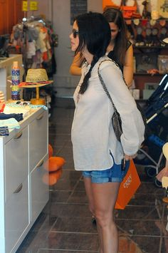 Rachel Bilson's cute little baby bump in shorts and a sweater.