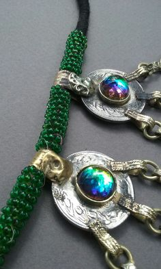 Just recieved these..loving  the irodesent  bezel on this Kuchi Necklace.