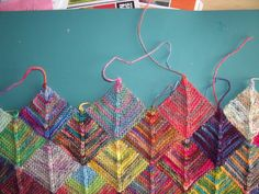 Knit Mitered Square Sock Blanket - lots of pictures and directions for this cheerful afghan - Loose Threads