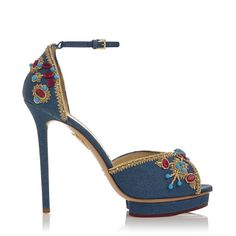 Standing atop a horseshoe 'island' platform, Savannah's d'orsay silhouette features an ornate appliqué of red and turquoise stones with gold thread. Bring a chic touch of Native American heritage to your ensembles with this beautiful shoe.