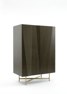 SIERRA CABINET BY CLAESSON KOIVISTO RUNE | The Sierra cabinets by Claesson Koivisto Rune were uniquely designed with a sculptural allure while carefully maintaining aesthetical balance and harmony. The doors are engineered with intricate precision to create a vibrant 3-D pattern on its surface. It is then covered with reconstituted (green) wood veneer that runs in different directions. As a result, the light reflects magnificently off of its subtle angles. | http://buffetsandcabinets.com/