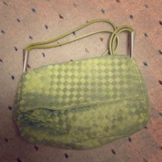 Bottega Veneta green handbag! This is a beautiful, authentic green handbag by Bottega Vaneta. The patchwork is green in color with no signs of wear with matching double green leather handle. Few scuffs on metal of handle, shown in pictures Bottega Veneta Bags