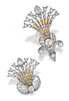 PAIR OF DIAMOND BROOCHES, CIRCA 1900 AND LATER.  Each designed as a fan-shaped stylised floral spray, decorated with foliate scrolls, set with pear-shaped, circular- and single-cut diamonds.