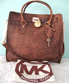 Micheal kors mocha ostrich bag. I would most definitely take this bad. It is gorgeous!