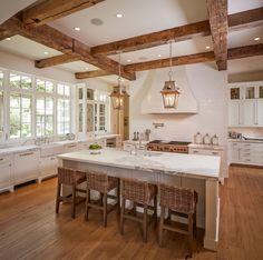 Amazing kitchen with lanterns on rustic wood beams over kitchen island paired with statuario marble, prep sink and seagrass bar stools over rustic wood floors. Beautiful Houses Interior, Beautiful Kitchens, Beautiful Homes, Seagrass Bar Stools, Prep Kitchen, Kitchen Island, Island Bar, Kitchen Sinks, Rustic Kitchen