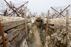 Inside view of a WWI trench at Massiges, northeastern France, on March 28, 2014. During the war, the battlefield between the Champagne and Argonne fronts was taken and lost several times by French and German troops between September 1914 and September 1915. During trench restoration works, in the last two years, the Main de Massiges Association has found seven bodies of WWI soldiers. (Reuters/Charles Platiau)