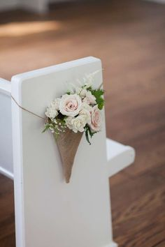 Hessian cone pew end with fresh flowers